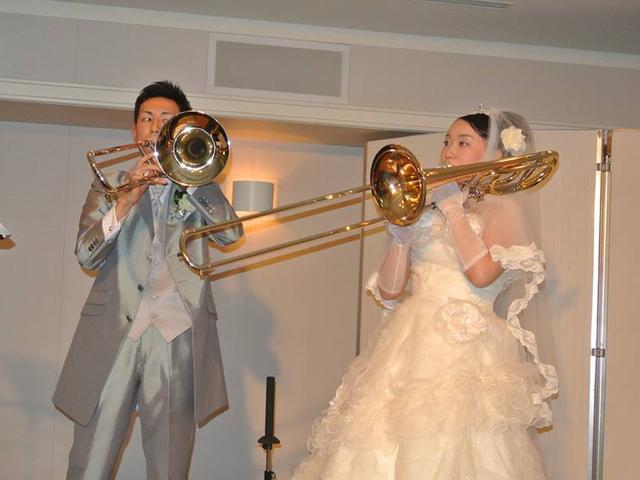 結婚式では楽器を吹いていました。